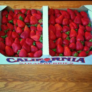 A flat of fresh strawberries, organically grown in the heart of Monterey Bay; Moss Landing, California. These beautiful berries, cultivated with love and sweat, will become Strawberry Jam.